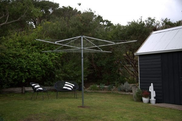 Hills Standard Non Hoisting Head clothesline set in he lawn of a back garden near to a shed and garden chairs
