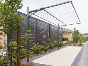 Austral Addaline fold down washing line mounted on a frame over a paved and planted garden area