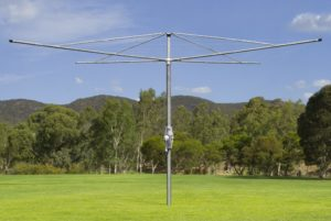 Austral Rotary Super 4 galvanised clothesline in a wide open lawn space
