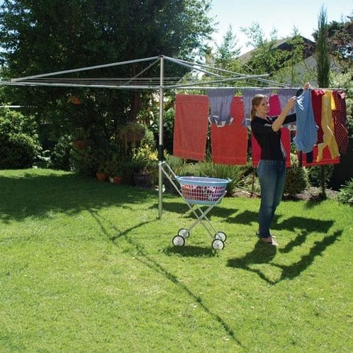 fixed head hoist washing line in garden with woman hanging out towels and clothes