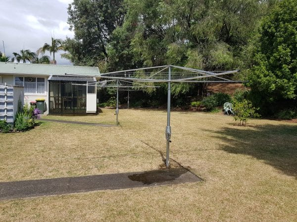 Outdoor Rotary Washing Line set in a back garden